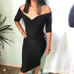 Long Sleeve long black tight dress.